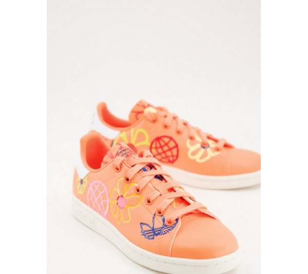 adidas Originals Sustainable Stan Smiths in orange with all over graphic print