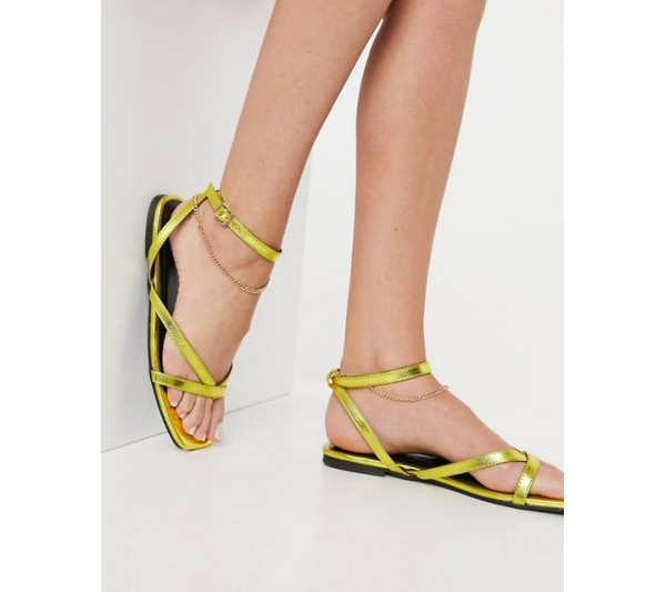DESIGN Flames flat sandals with ankle chain in gold
